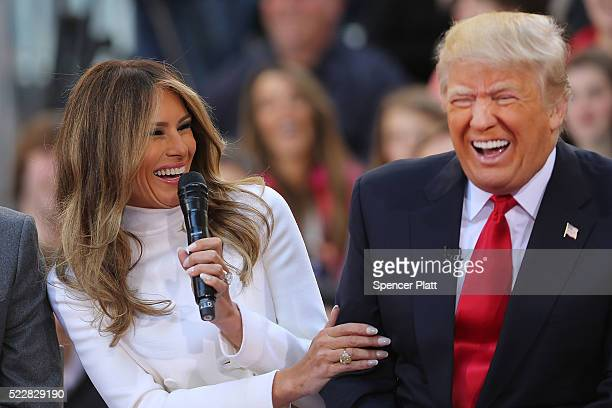 Republican presidential candidate Donald Trump sits with his wife Melania Trump while appearing at an NBC Town Hall at the Today Show on April 21,...