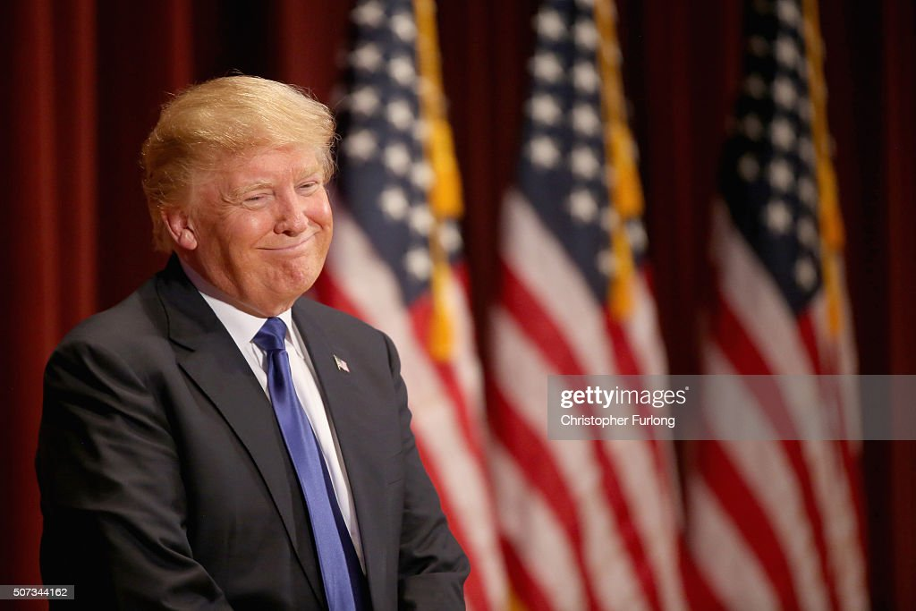Republican presidential candidate Donald Trump smiles as he speaks to veterans at Drake University on January 28, 2016 in Des Moines, Iowa. Donald Trump held his alternative event to benefit veterans after withdrawing from the televised Fox News/Google GOP debate which airs at the same time.