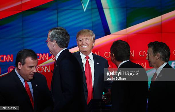 Republican presidential candidate Donald Trump smiles as New Jersey Gov Chris Christie Jeb Bush Ohio Gov John Kasich and US Sen Rand Paul walk...