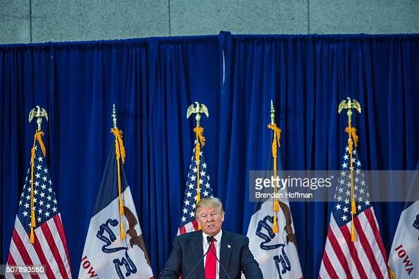 Republican presidential candidate Donald Trump speaks at a campaign rally at the Ramada Waterloo Hotel and Convention Center on February 1 2016 in...