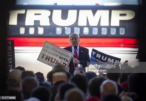 Republican Presidential candidate Donald Trump speaks at a campaign rally in an airplane hanger at Northwest Arkansas Regional Airport on February 27...