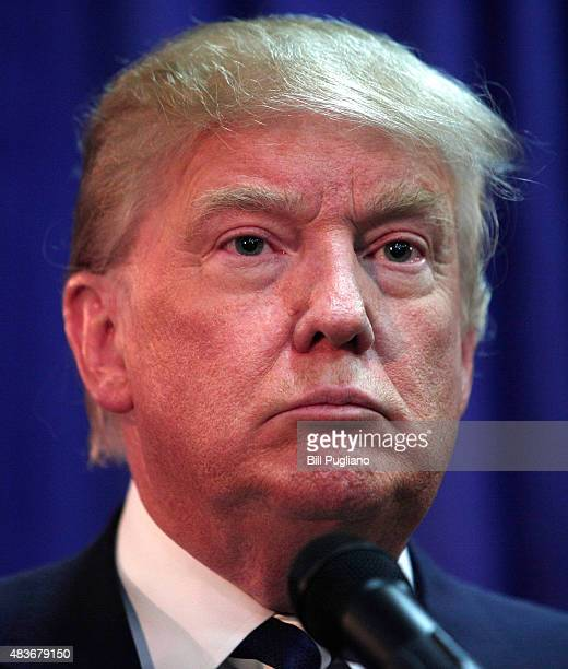 Republican presidential candidate Donald Trump speaks at a press conference before delivering the keynote address at the Genesee and Saginaw...