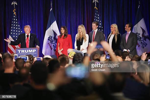 Republican presidential candidate Donald Trump speaks at his Iowa Caucus night gathering while his wife Melania , daughter-in-law Lara Yunaska, son...