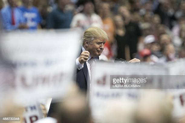 US Republican presidential candidate Donald Trump speaks during a campaign rally at the American Airlines Center in Dallas on September 14 2015 AFP...