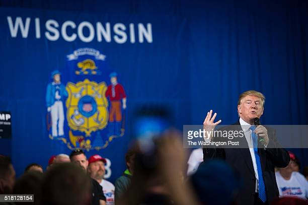 Republican presidential candidate Donald Trump speaks during a campaign town hall event at the Janesville Conference Center in Janesville WI on...