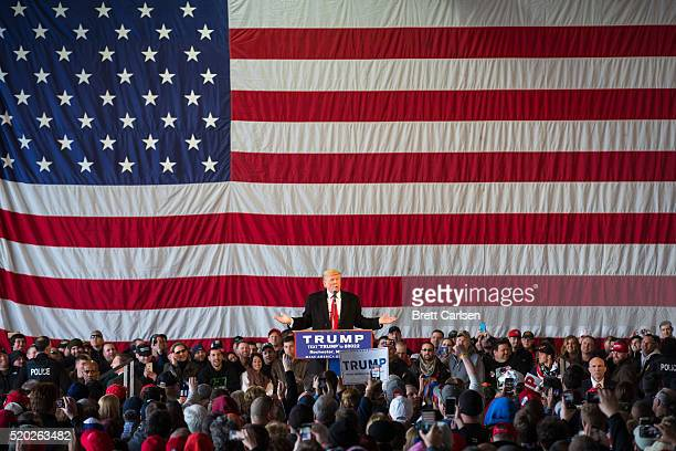 Republican presidential candidate Donald Trump speaks in front of a capacity crowd at a rally for his campaign on April 10 2016 in Rochester New York...