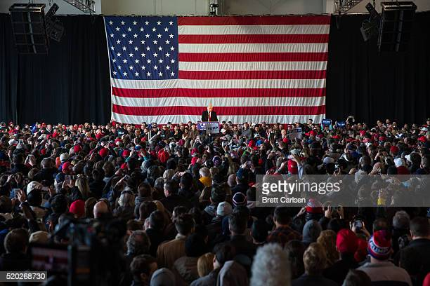 Republican presidential candidate Donald Trump speaks in front of a capacity crowd at a rally for his campaign on April 10, 2016 in Rochester, New...