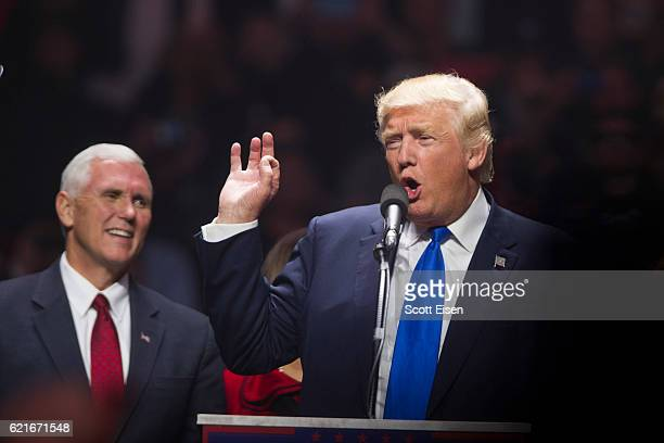 Republican presidential candidate Donald Trump speaks on stage with running mate Indiana Governor Mike Pence during a rally at the SNHU Arena on...