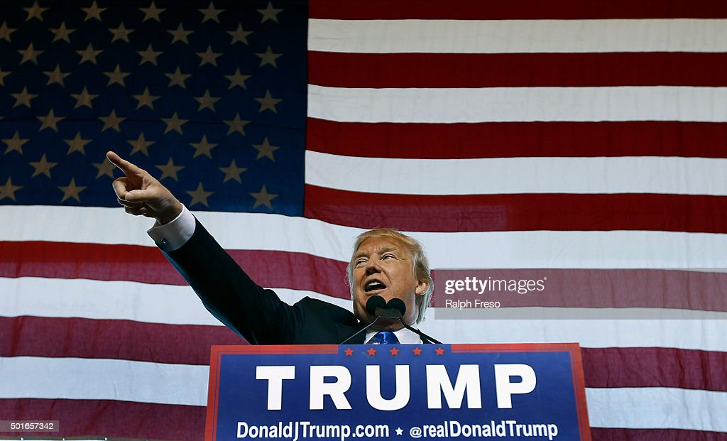 Republican presidential candidate Donald Trump speaks to guest gathered during a campaign event at the International Air Response facility on December 16, 2015 in Mesa, Arizona. Trump is in Arizona the day after the Republican Presidential Debate hosted by CNN in Las Vegas, Nevada.