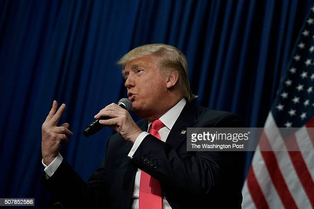 Republican presidential candidate Donald Trump speaks to guests during a campaign rally at the Gerald W Kirn Middle School on January 31 2016 in...