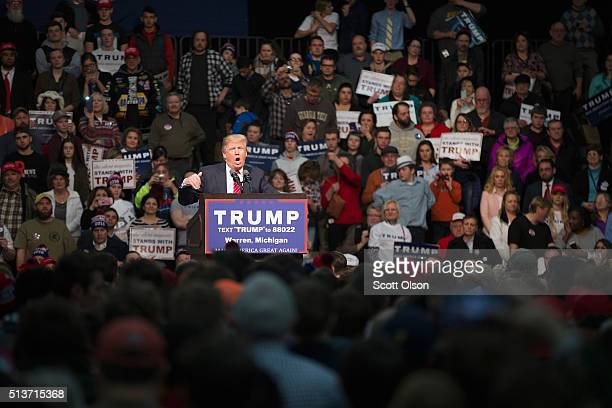 Republican presidential candidate Donald Trump speaks to guests during a rally at Macomb Community College on March 4 2016 in Warren Michigan Voters...