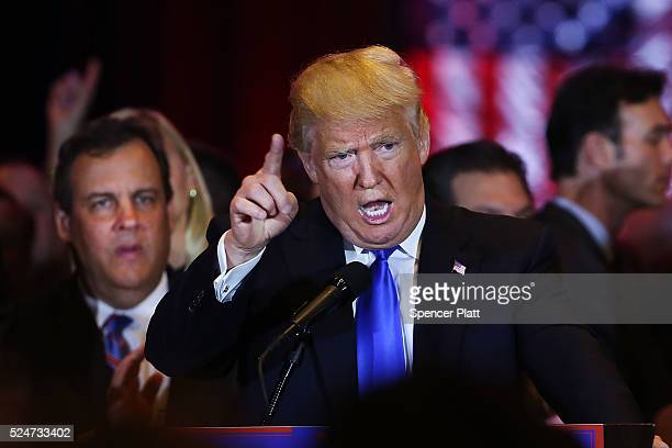 Republican presidential candidate Donald Trump speaks to supporters and the media with New Jersey Governor Chris Christie behind him at Trump Towers...