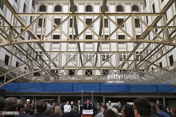 Republican presidential candidate Donald Trump speaks to the media at the Trump International Hotel that is currently under construction March 21...