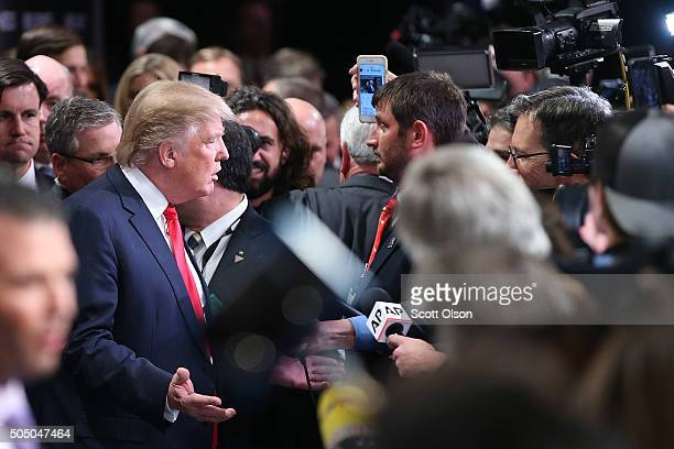 Republican presidential candidate Donald Trump speaks to the media in the spin room after the Fox Business Network Republican presidential debate at...