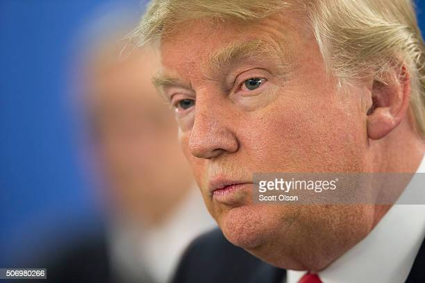 Republican presidential candidate Donald Trump speaks to the press prior to a rally on January 26 2016 in Marshalltown Iowa Sheriff Joe Arpaio the...
