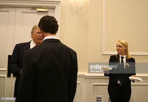 Republican presidential candidate Donald Trump speaks with former Yankee baseball player Paul O'Neill as he arrives for a press conference at the...