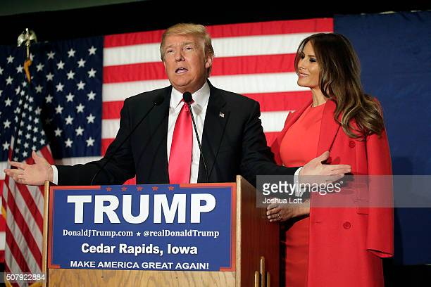 Republican presidential candidate Donald Trump speaks with his wife Melania Trump by his side during a campaign event at the US Cellular Convention...
