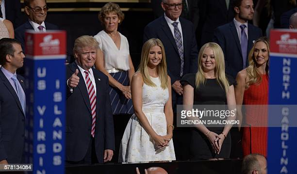 TOPSHOT Republican presidential candidate Donald Trump stands with his son Donald Trump Jr daughters Ivanka Trump and Tammy Trump and daughterinlaw...