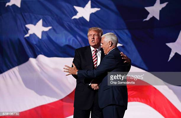 Republican presidential candidate Donald Trump stands with Republican vice presidential candidate Mike Pence after he delivered a speech on the third...