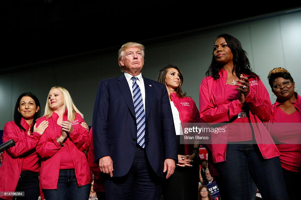 Republican presidential candidate Donald Trump stands with Women for Trump as he speaks to supporters at a rally on October 14, 2016 at the Charlotte Convention Center in Charlotte, North Carolina. Trump continues to campaign for his run for president of the United States.