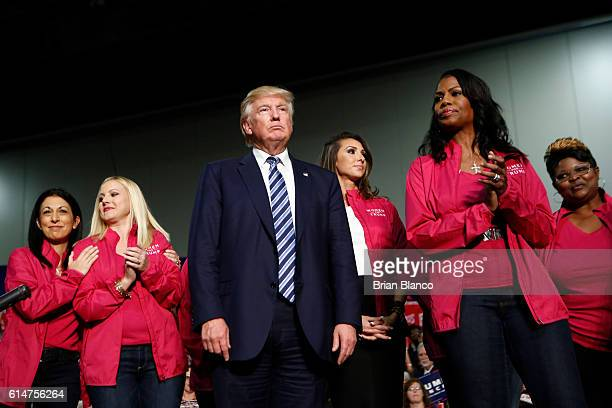 Republican presidential candidate Donald Trump stands with Women for Trump as he speaks to supporters at a rally on October 14 2016 at the Charlotte...