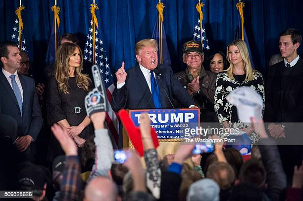 Republican presidential candidate Donald Trump surrounded by family and friends shouts as he celebrates his victory at a New Hampshire primary...