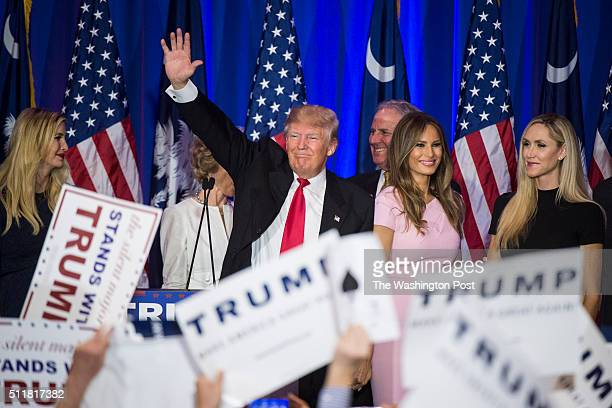 Republican presidential candidate Donald Trump surrounded by friends and family speaks after winning the South Carolina Republican presidential...