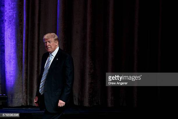 Republican presidential candidate Donald Trump takes the stage before introducing his newly selected vice presidential running mate Mike Pence...