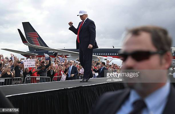 Republican presidential candidate Donald Trump takes to the stage to speak during a campaign rally at the Lakeland Linder Regional Airport on October...