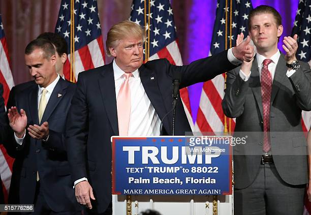 Republican presidential candidate Donald Trump thanks supporters after delivering remarks at the MarALago Club's Donald J Trump Ballroom March 15...