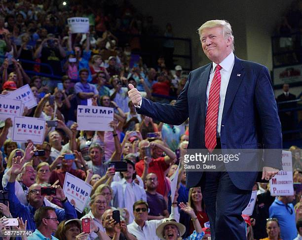 Republican presidential candidate Donald Trump thumbsup the crowd during a campaign event at Trask Coliseum on August 9 2016 in Wilmington North...