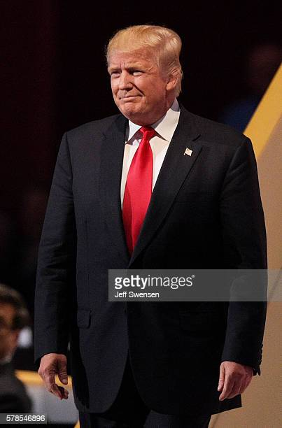 Republican presidential candidate Donald Trump walks on stage after his daughter Ivanka Trump introduced him during the evening session on the fourth...