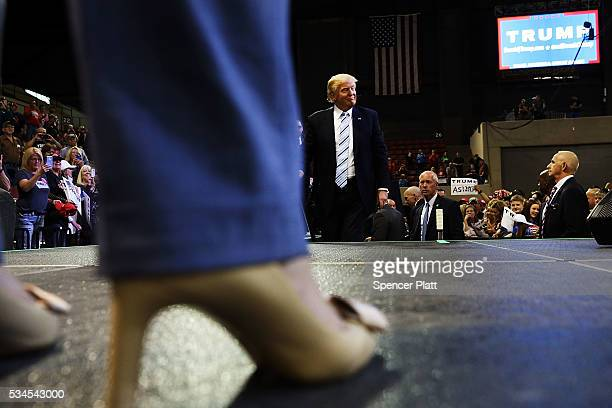 Republican presidential candidate Donald Trump walks onto stage as one of his press advisors following a speech at a rally on May 26 2016 in Billings...