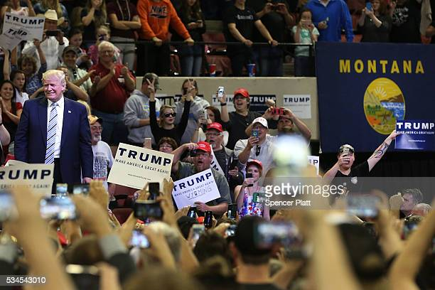 Republican presidential candidate Donald Trump walks onto stage at a rally on May 26 2016 in Billings Montana According to a delegate count released...