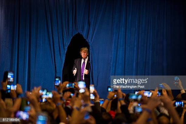 Republican presidential candidate Donald Trump walks out to speak during a campaign watch party on the day of the Nevada republican caucus at the...