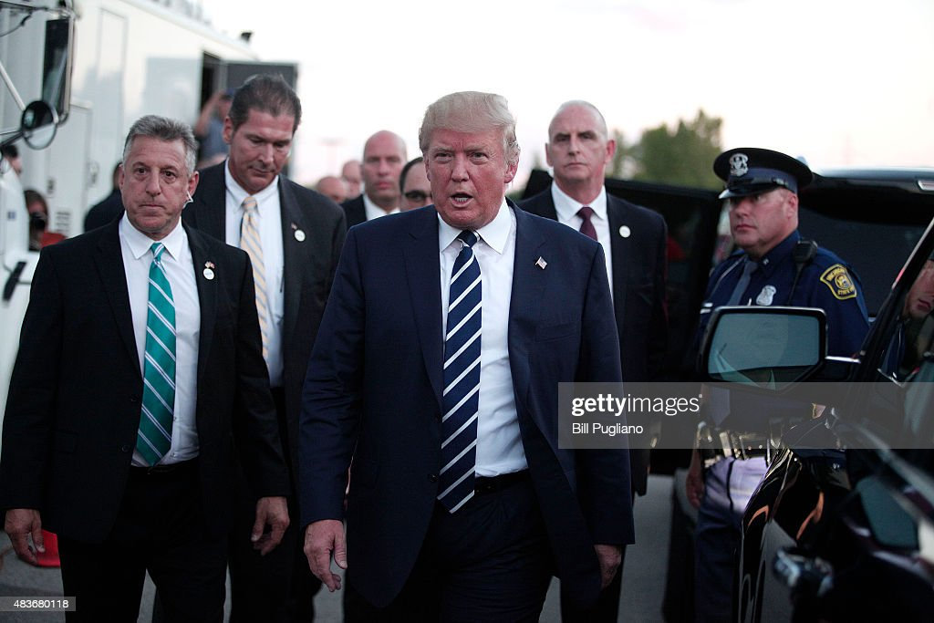 Republican presidential candidate Donald Trump walks to his car after delivering the keynote address at the Genesee and Saginaw Republican Party Lincoln Day Event August 11, 2015 in Birch Run, Michigan. This is Trump's first campaign event since his Republican debate last week.