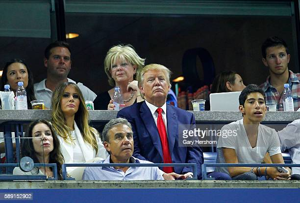 Republican presidential candidate Donald Trump watches Serena Williams of the US play her sister Venus Williams at the US Open tennis tournament in...