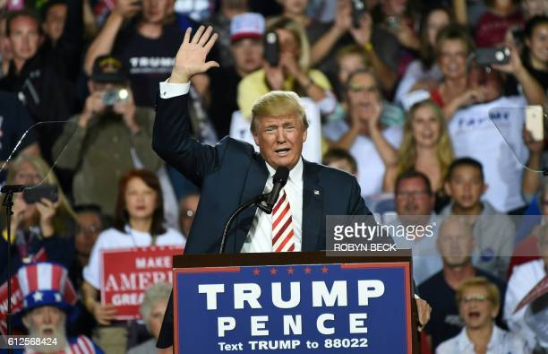 TOPSHOT Republican presidential candidate Donald Trump waves during a campaign rally at the Prescott Valley Event Center October 4 2016 in Prescott...