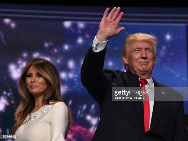 Republican presidential candidate Donald Trump waves next to his wife Melania Trump after accepting the party nomination on the last day of the...