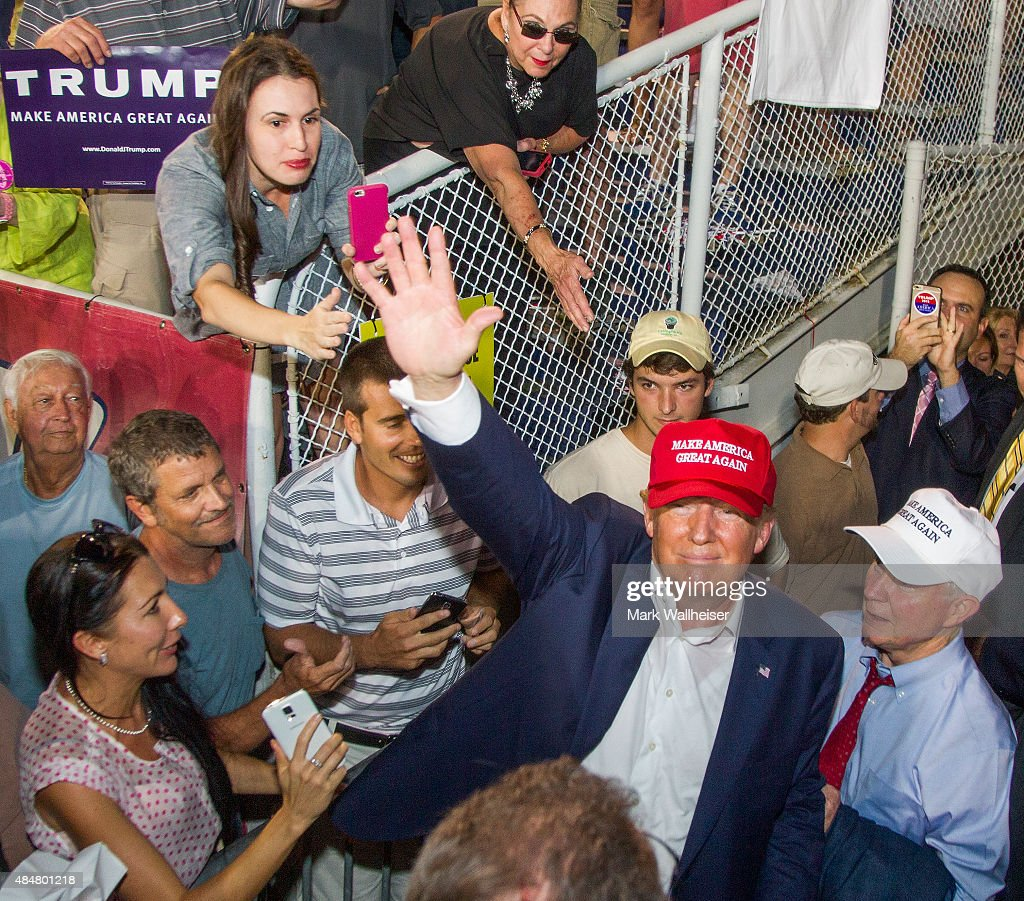 Republican presidential candidate Donald Trump waves to supporters after his rally at Ladd-Peebles Stadium on August 21, 2015 in Mobile, Alabama. The Trump campaign moved tonight's rally to a larger stadium to accommodate demand.