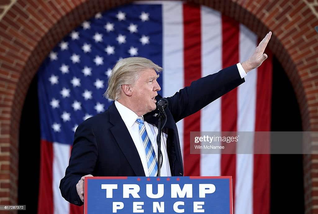 Republican presidential candidate Donald Trump waves to supporters while campaigning at Regent University October 22, 2016 in Virginia Beach, Virginia. The U.S. holds its presidential election in 17 days.