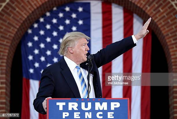 Republican presidential candidate Donald Trump waves to supporters while campaigning at Regent University October 22 2016 in Virginia Beach Virginia...