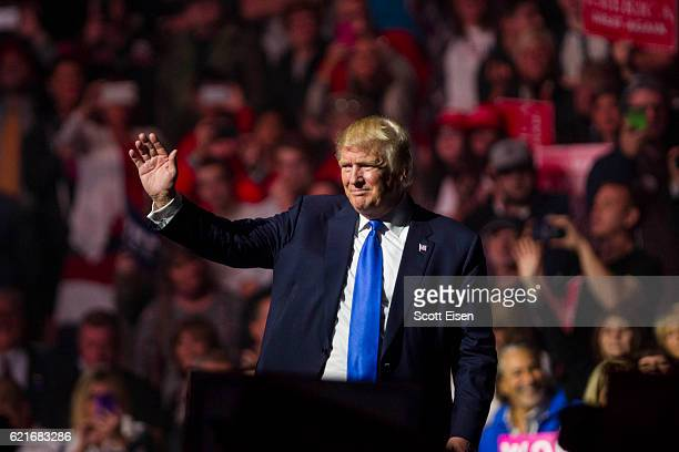Republican presidential candidate Donald Trump waves to supports at the end of his rally at the SNHU Arena on November 7 2016 in Manchester New...