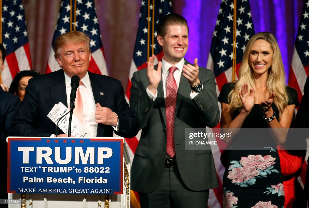 Republican presidential candidate Donald Trump (L), with his son Eric Trump (C) and daughter-in-law, Lara Trump (R), addresses the media following victory in the Florida state primary on March 15, 2016 in West Palm Beach, Florida. / AFP PHOTO / RHONA WISE / The erroneous mentions appearing in the metadata of these photos by RHONA WISE has been modified in AFP systems in the following manner: [Republican presidential candidate Donald Trump (L), with his son Eric Trump (C) and daughter-in-law, Lara Trump (R),] instead of [Republican presidential candidate Donald Trump (L) with his son Donald Trump Jr (C) and daughter - in - law Vanessa Trump (R)]. Please immediately remove the erroneous mentions from all your online services and delete them from your servers. If you have been authorized by AFP to distribute them to third parties, please ensure that the same actions are carried out by them. Failure to promptly comply with these instructions will entail liability on your part for any continued or post notification usage. Therefore we thank you very much for all your attention and prompt action. We are sorry for the inconvenience this notification may cause and remain at your disposal for any further information you may require.