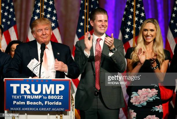 Republican presidential candidate Donald Trump , with his son Eric Trump and daughter-in-law, Lara Trump , addresses the media following victory in...