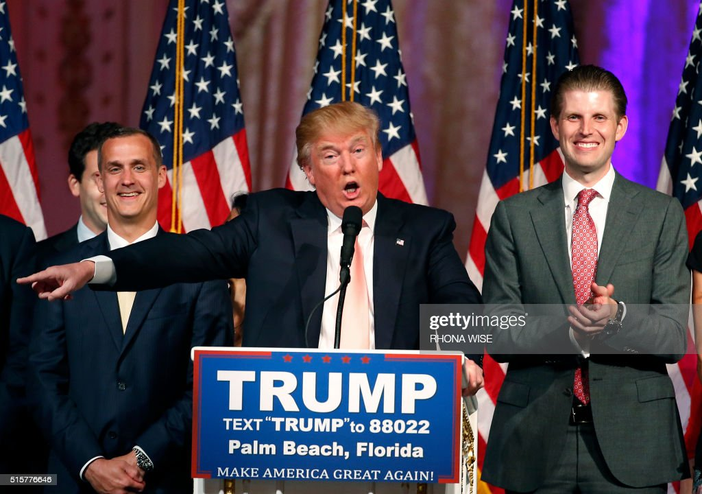 Republican presidential candidate Donald Trump (C) with his son, Eric (R), addresses the media following victory in the Florida state primary on March 15, 2016 in West Palm Beach, Florida. The win in Florida for Trump sent rival Marco Rubio, the US senator from the Sunshine State, crashing out of the campaign. The 69-year-old billionaire also won in Illinois and North Carolina. / AFP PHOTO / RHONA WISE / The erroneous mentions appearing in the metadata of these photos by RHONA WISE has been modified in AFP systems in the following manner: [Republican presidential candidate Donald Trump (C) with his son, Eric (R),] instead of [Republican presidential candidate Donald Trump (C) with his son Donald Trump Jr (R)]. Please immediately remove the erroneous mentions from all your online services and delete them from your servers. If you have been authorized by AFP to distribute them to third parties, please ensure that the same actions are carried out by them. Failure to promptly comply with these instructions will entail liability on your part for any continued or post notification usage. Therefore we thank you very much for all your attention and prompt action. We are sorry for the inconvenience this notification may cause and remain at your disposal for any further information you may require.