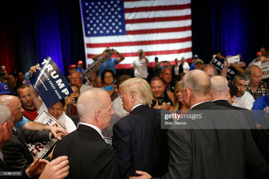 Republican presidential candidate Donald Trump works the rope line after speaking to supporters during a town hall meeting on March 14, 2016 at the Tampa Convention Center in Tampa , Florida. Trump is campaigning ahead of the Florida primary on March 15.