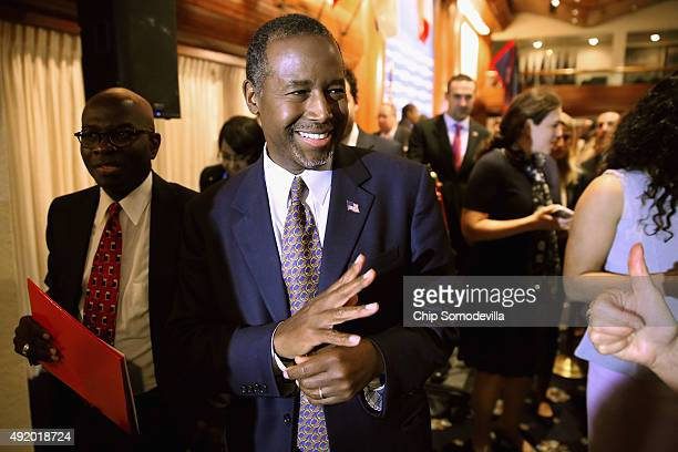 Republican presidential candidate Dr Ben Carson waves to supporters after addressing the National Press Club Newsmakers Luncheon October 9 2015 in...