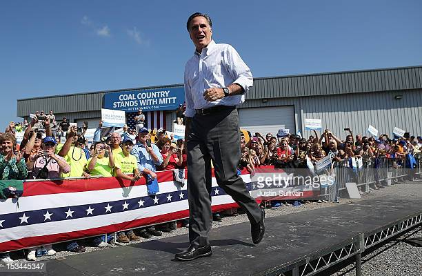 Republican presidential candidate former Massachusetts Gov Mitt Romney greets supporters during a campaign rally on October 5 2012 in Abingdon...