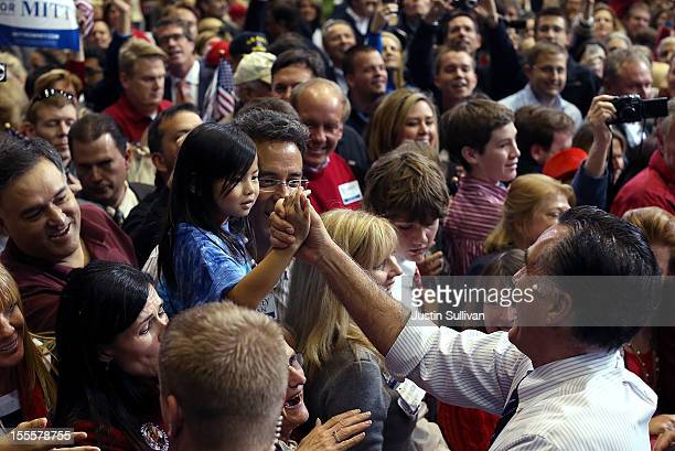 Republican presidential candidate former Massachusetts Gov Mitt Romney greets supporters during a campaign rally at George Mason University on...